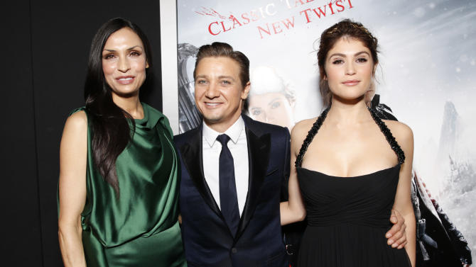 """Famke Janssen, Jeremy Renner and Gemma Arterton arrive at the premiere of """"Hansel & Gretel Witch Hunters"""" on Thursday Jan. 24, 2013, in Los Angeles.  (Photo by Todd Williamson/Invision/AP)"""