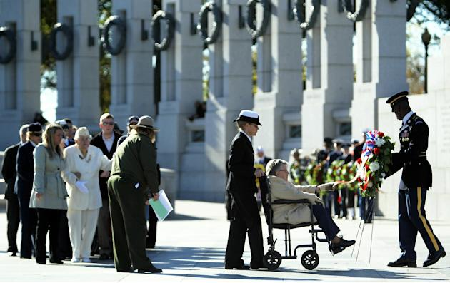 Female Veterans Lay Wreath At World War II Memorial In Washington