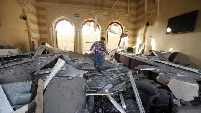 A man walks over rubble from a blast, seen inside the Islamic Art Museum after a bomb attack in downtown Cairo