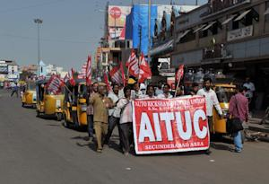 Members of an auto rickshaw taxi drivers union participate …