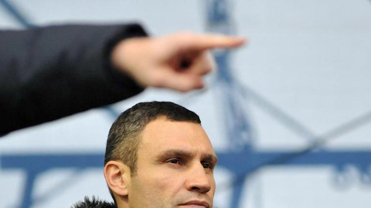 Ukrainian opposition leader Vitali Klitschko stands on a platform during a rally in Kiev, on December 13, 2013