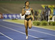 Jamaican sprinter Shelly-Ann Fraser-Pryce runs during the women&#39;s 200m dash final of the Jamaican Olympic Athletic Trials at the National Stadium in Kingston, July 01, 2012. Shelly-Ann Fraser-Pryce won the race with a time of 22.10sec