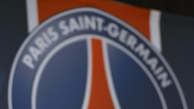 British soccer player David Backham, is seen during a press conference at the Parc des Princes stadium in Paris, Thursday, Jan. 31, 2013.  Beckham will join Paris Saint-Germain on Thursday, opting for a move to France after mulling over lucrative offers from around the world since leaving the Los Angeles Galaxy.(AP Photo/Benjamin Girette)