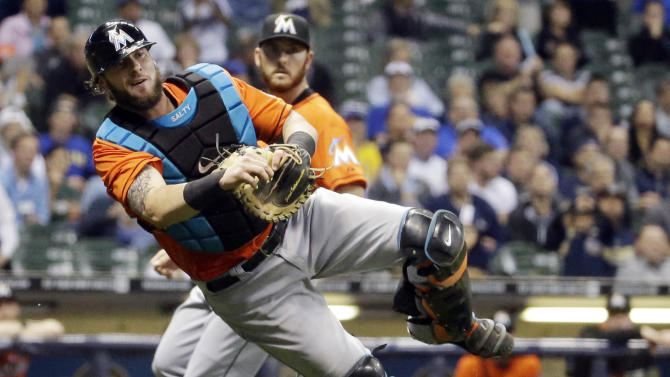 FILE - In a Sept. 10, 2014, file photo Miami Marlins catcher Jarrod Saltalamacchia makes a wild throw to first during the seventh inning of a baseball game in Milwaukee.  Saltalamacchia has been designated for assignment by the Miami Marlins. (AP Photo/Morry Gash, file)
