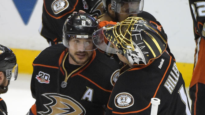 Anaheim Ducks right wing Teemu Selanne, of Finland,, left, gets a pat on the head from goalie Jonas Hiller, of Switzerland, after Game 7 of an NHL hockey second-round Stanley Cup playoff series against the Los Angeles Kings, Friday, May 16, 2014, in Anaheim, Calif. The Kings won 6-2