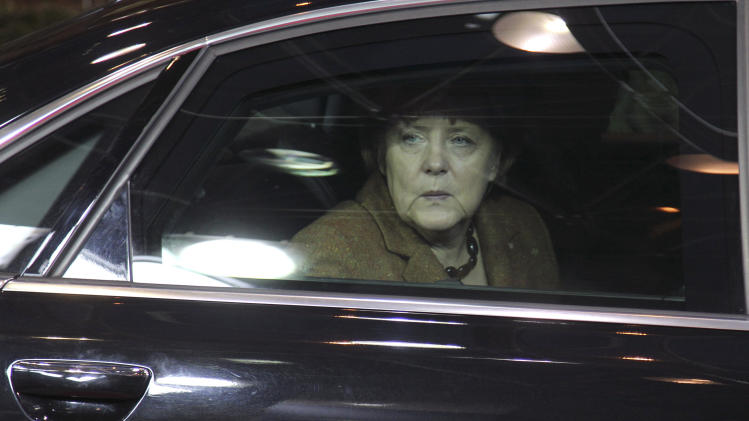 German Chancellor Angela Merkel looks out of her car window as she arrives for an EU summit in Brussels on Thursday, Nov. 22, 2012. EU leaders begin what is expected to be a marathon summit on the budget for the years 2014-2020. The meeting could last through Saturday and break up with no result and lots of finger-pointing. (AP Photo/Yves Logghe)