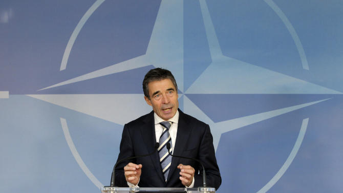 NATO Secretary General Anders Fogh Rasmussen addresses the media at NATO headquarters,  in Brussels, Thursday, Feb. 21, 2013. NATO defense ministers attended a two-day meeting to discuss Syria and Afghanistan. (AP Photo/Yves Logghe)