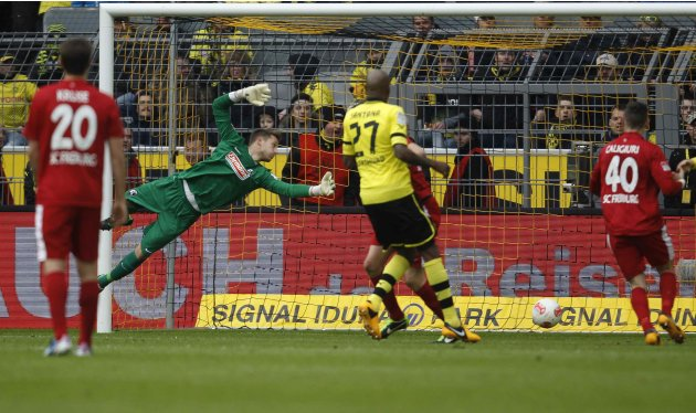 Borussia Dortmund's Lewandowski scores a goal against Freiburg during the German first division Bundesliga soccer match in Dortmund