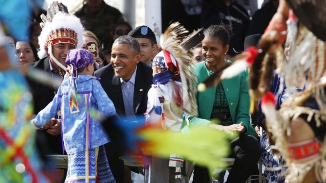 U.S. President Barack Obama and first lady, Michelle Obama, attend the Cannon Ball Flag Day celebration in North Dakota