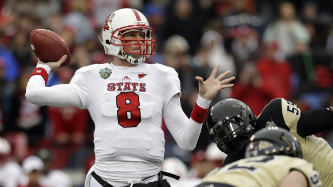 North Carolina State quarterback Mike Glennon (8) passes against Vanderbilt in the first quarter of the Music City Bowl NCAA college football game on Monday, Dec. 31, 2012, in Nashville, Tenn. (AP Photo/Mark Humphrey)