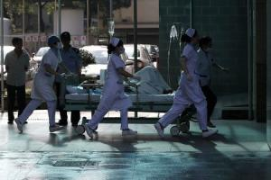 Medical personnel transport a victim of a factory explosion, at a hospital in Kunshan