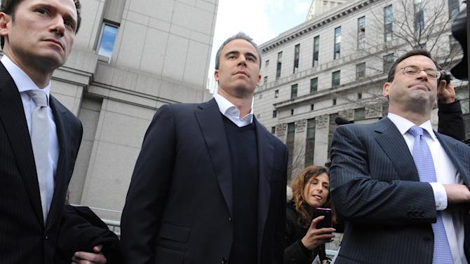 Michael Steinberg, center, exits Manhattan federal court with his attorney Barry Berke, Friday,March 29. 2013, in New York. A senior portfolio manager for SAC Capital Advisors, one of the largest U.S. hedge funds was arrested Friday, accused of making $1.4 million illegally in a widening insider trading probe involving an investment company founded by billionaire businessman Steven A. Cohen. (AP Photo/Louis Lanzano)
