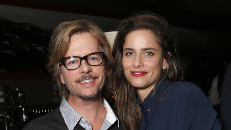 David Spade and Amanda Peet attend the DETAILS Hollywood Mavericks Party on Thursday, Nov. 29, 2012 in Los Angeles. (Photo by Todd Williamson/Invision for Details Magazine/AP Images)