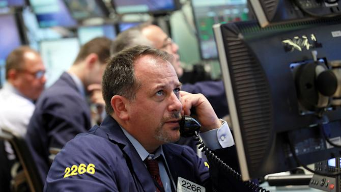 Broker Paul A. Mandile works the trading floor of the New York Stock Exchange short time  after the opening bell at the New York Stock Exchange up Thursday, Sept.. 6,  2012  (AP Photo/David Karp)