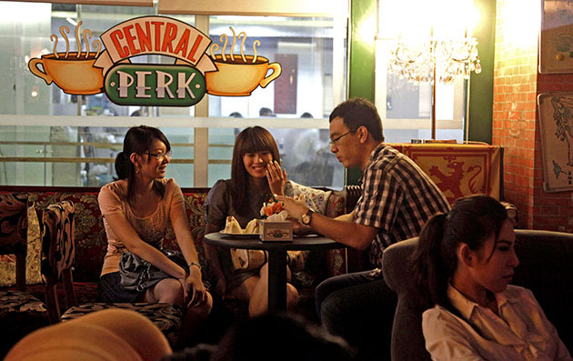 "Chinese youths chat at a cafe modeled after the ""Central Perk"" cafe in the ""Friends"" sitcom long popular amongst young Chinese audience in Beijing Monday, July 19, 2010. The long running series on NBC ended in 2004 but still enjoys a strong following in China where its fans can easily access the series online or on DVDs."