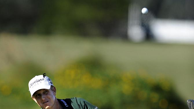 David Toms watches his chip in from the rough on the 18th green during the final round of the McGladrey Classic PGA Tour golf tournament, Sunday, Oct. 21, 2012, in St. Simons Island, Ga. Toms finished the tournament in second. (AP Photo/Stephen Morton)