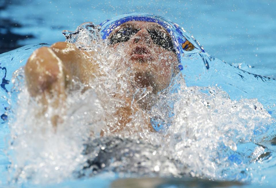 Ryan Lochte swims to victory in the men's 200-meter backstroke final at the U.S. Olympic swimming trials, Saturday, June 30, 2012, in Omaha, Neb. (AP Photo/Mark J. Terrill)
