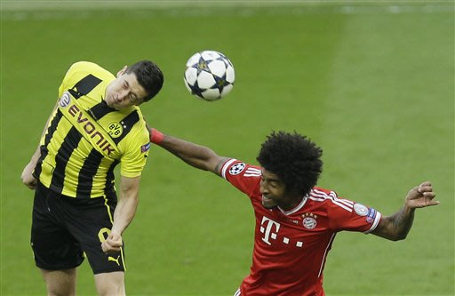 Dortmund's Robert Lewandowski of Poland, left, and Bayern's Dante of Brazil go for a header during the Champions League Final soccer match between  Borussia Dortmund and Bayern Munich at Wembley Stadi