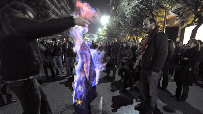 """FILE - Demonstrators burn an EU flag in this file photo dated Thursday Nov. 17, 2011, in Thessaloniki, Greece.  It is announced Friday Oct. 12, 2012, that the European Union has been awarded the Nobel Peace Prize for its efforts to promote peace and democracy in Europe, in the midst of the union's biggest crisis since its creation in the 1950s. The Norwegian prize committee said the EU receives the award for six decades of contributions """"to the advancement of peace and reconciliation, democracy and human rights in Europe. (AP Photo/ Nikolas Giakoumidis, File)"""