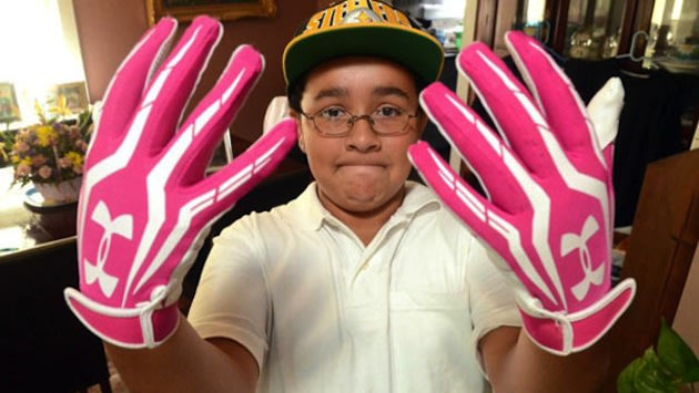 New Jersey middle schooler Julian Connerton shows his infamous pink gloves &#x002014; ABC News/Danny Drake/Press of Atlantic City