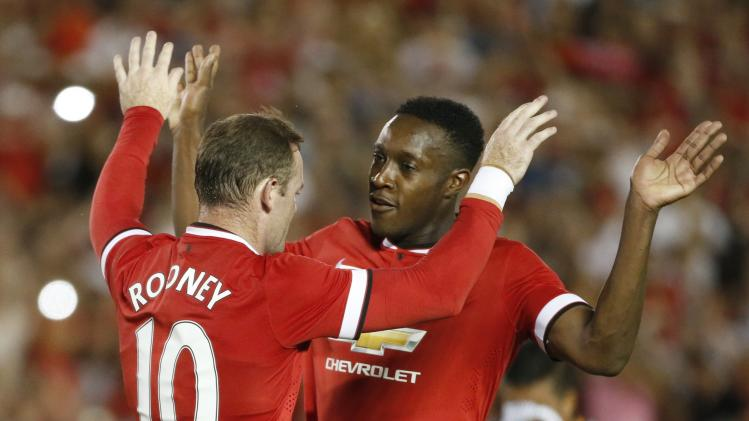 Manchester United forwards Rooney and Welbeck celebrate after Rooney scored their second goal against Los Angeles Galaxy during the first half of their international soccer friendly match in Pasadena