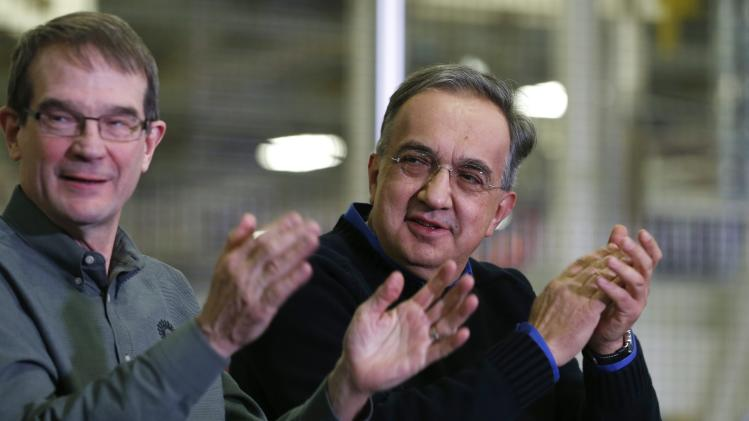Chrysler Group LLC Chairman and CEO Marchionne and United Auto Workers Union President King celebrate during the production launch celebration of the 2015 Chrysler 200 vehicle at the Sterling Heights Assembly Plant in Michigan