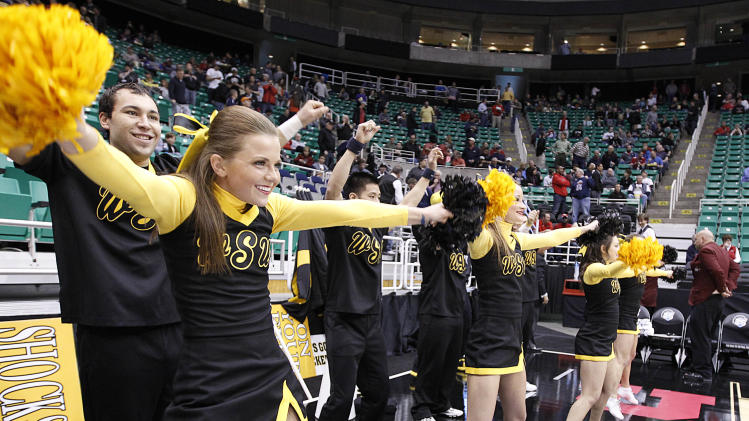 Wichita State cheerleaders preform before their game against Pittsburgh in a second-round game in the NCAA college basketball tournament in Salt Lake City Thursday, March 21, 2013. (AP Photo/George Frey)