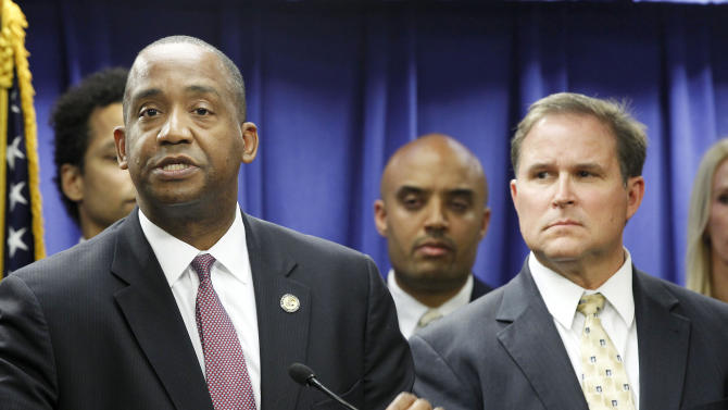 U.S. Attorney Andre Birotte, left, and FBI Assistant Director in Charge Bill Lewis speak at news conference Friday, Feb. 21, 2014, in Los Angeles. Federal law enforcement authorities on Friday announced multiple charges of bribery and cover-ups against state Sen. Ron Calderon, a Democratic state lawmaker and his brother, the result of a long-running corruption investigation that has tarnished the state's majority party. (AP Photo/ Nick Ut)