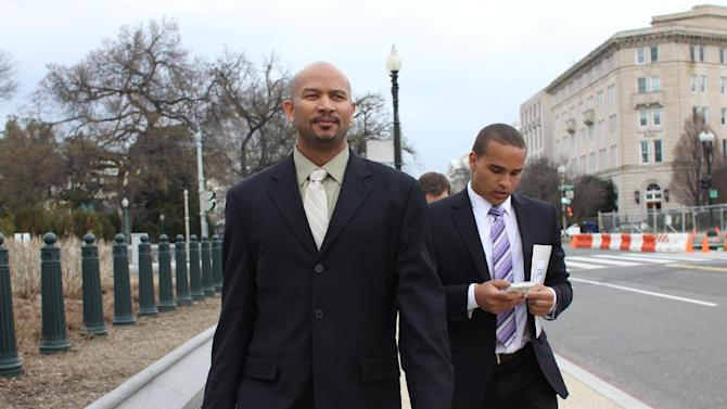 FILE - This April 2, 2014 file photo shows former Northwestern University football quarterback Kain Colter, right, and Ramogi Huma, founder and president of the National College Players Association arrive on Capitol Hill in Washington. The United Steelworkers union and college football players may seem like an unlikely pairing. Yet the sprawling union is locked in a high-stakes standoff with Northwestern University over whether student athletes on scholarships should be allowed to unionize, engage in collective bargaining and even strike. At first glance, it may seem like a big reach on the part of the union. But it's been a long time since the Steelworkers Union just represented workers at steel mills and in other jobs directly related to steel. (AP Photo/Lauren Victoria Burke, File)