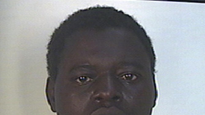 This undated photo made available Saturday, May 11, 2013 by Italian Carabinieri paramilitary police shows a man identified as Kabobo Mada, 21, from Ghana. Police say an immigrant from Ghana went on a rampage with a pickaxe in Milan, killing a passerby and wounding four others in an apparently random attack. Carabinieri paramilitary police in Milan said the attacker was taken into custody shortly after the attacks Saturday morning in a neighborhood on the northern outskirts of the city. Slain was a 40-year-old man who was struck on the head with the pickaxe, then, while lying wounded on the ground on his back, suffered pickaxes blows to the abdomen, police said. (AP Photo/Italian Carabinieri police, ho)