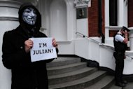 A protester wearing a Guy Fawkes mask demonstrates outside the Ecuadorian embassy in London, on June 23, 2012, where Wikileaks founder Julian Assange is seeking political asylum. Assange Monday called for diplomatic guarantees he will not be pursued by the United States for publishing secret documents if he goes to Sweden to face criminal allegations.