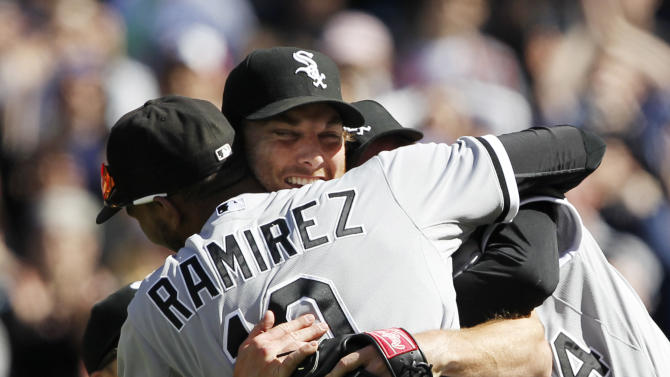 Chicago White Sox starting pitcher Phil Humber, center, is mobbed by teammates after pitching a perfect baseball game against the Seattle Mariners, Saturday, April 21, 2012, in Seattle. The White Sox won 4-0. (AP Photo/Elaine Thompson)