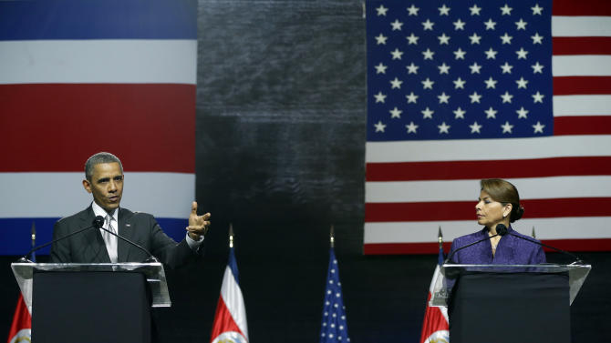 President Barack Obama, left, speaks during a news conference alongside Costa Rica President Laura Chinchilla at the National Center for Art and Culture in San Jose, Costa Rica, Friday, May 3, 2013. (AP Photo/Pablo Martinez Monsivais)