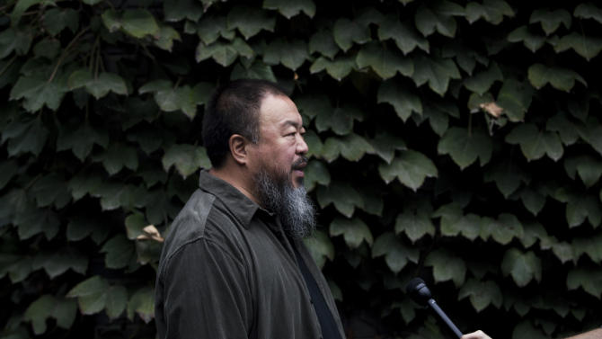 """Chinese dissident artist Ai Weiwei speaks to a journalist at his studio, before he head to the Beijing No. 2 People's Intermediate Court for his appeal in Beijing Thursday, Sept. 27, 2012. Chinese authorities on Thursday rejected Ai's second and final appeal of a $2.4 million tax fine, a ruling he said sprang from a """"barbaric and backward legal system."""" (AP Photo/Andy Wong)"""