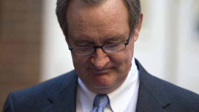 Sen. Michael Crapo, R-Idaho looks down as he reads a statement outside Alexandria General District Court in Alexandria, Va., Friday, Jan. 4, 2013, after pleading guilty Friday to a misdemeanor first-offense drunken driving charge. In exchange for his plea Friday, prosecutors dropped a charge of failing to obey a traffic signal. Crapo received a $250 fine and a 12-month suspension of his driver's license and must complete an alcohol safety program.  (AP Photo/ Evan Vucci)