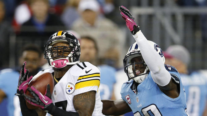 Pittsburgh Steelers wide receiver Mike Wallace (17) hauls in a catch for a touchdown as Tennessee Titans cornerback Jason McCourty defends during the first half of an NFL football game Thursday, Oct. 11, 2012, in Nashville, Tenn. (AP Photo/Joe Howell)