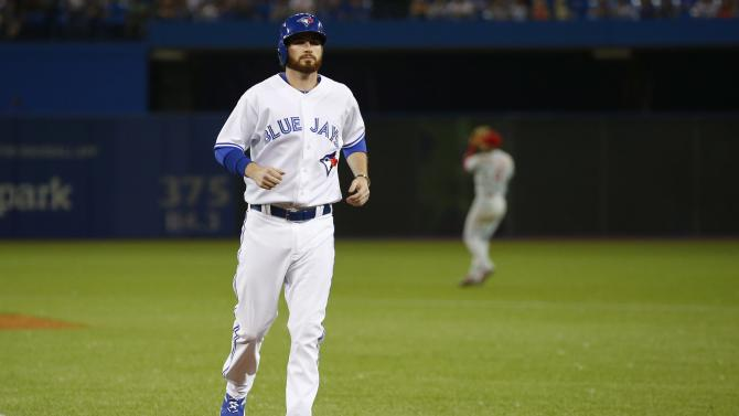 Toronto Blue Jays pitcher Drew Hutchison is sent in as a pinch runner against the Philadelphia Phillies during the ninth inning of an interleague baseball game, Tuesday, July 28, 2015 in Toronto. (Mark Blinch/The Canadian Press via AP) MANDATORY CREDIT