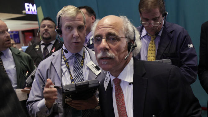 Traders Richard Cohen, left center, and Peter Tuchman, foreground right, work on the floor of the New York Stock Exchange Wednesday, Oct. 3, 2012. Stocks are mostly higher in early trading on Wall Street Wednesday after a measure of private sector hiring came in better than economists were expecting. (AP Photo/Richard Drew)