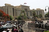 Egyptian military police stand guard outside Cairo's Supreme Constitutional Court in June 2012. After parliament was annulled last month, the SCAF issued a constitutional declaration granting the military sweeping powers