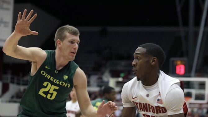 Stanford's Gabriel Harris, right, drives the ball against Oregon's E.J. Singler (25) during the first half of an NCAA college basketball game Wednesday, Jan. 30, 2013, in Stanford, Calif. (AP Photo/Ben Margot)