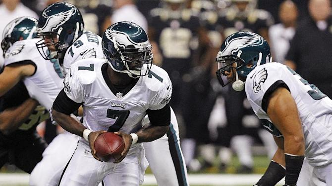 Philadelphia Eagles quarterback Michael Vick (7) drops back to hand off during the first half of an NFL football game against the New Orleans Saints at Mercedes-Benz Superdome in New Orleans, Monday, Nov. 5, 2012. (AP Photo/Gerald Herbert)