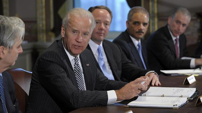 Vice President Joe Biden, second from left, with Attorney General Eric Holder, second from right, speaks during a meeting with representatives from the video game industry in the Eisenhower Executive Office Building on the White House complex in Washington, Friday, Jan. 11, 2013. Biden is holding a series of meetings this week as part of the effort he is leading to develop policy proposals in response to the Newtown, Conn., school shooting. Entertainment Software Association President Mike Gallagher sits between Biden and Holder.  (AP Photo/Susan Walsh)