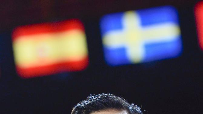 Javier Fernandez of Spain poses with the gold medal at the European Figure Skating Championships in Stockholm