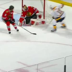 Neal slides the puck past Darling's pad