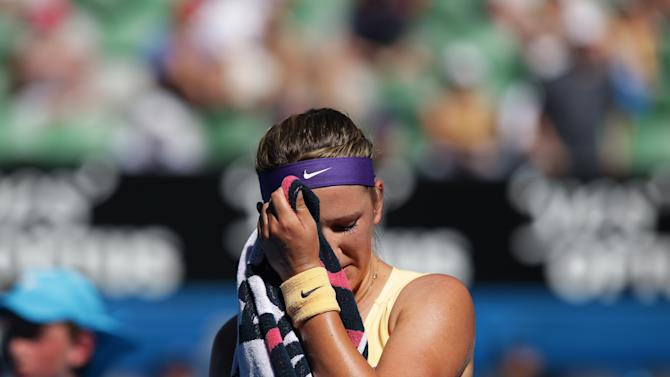 Victoria Azarenka of Belarus reacts during her semifinal match against Sloane Stephens of the US at the Australian Open tennis championship in Melbourne, Australia, Thursday, Jan. 24, 2013. (AP Photo/Aaron Favila)