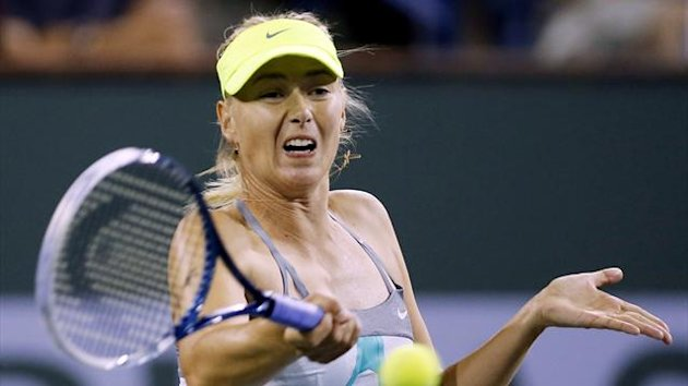Maria Sharapova of Russia returns a shot against Sara Errani of Italy during their women's singles quarterfinal match at the BNP Paribas Open WTA tennis tournament in Indian Wells (Reuters)