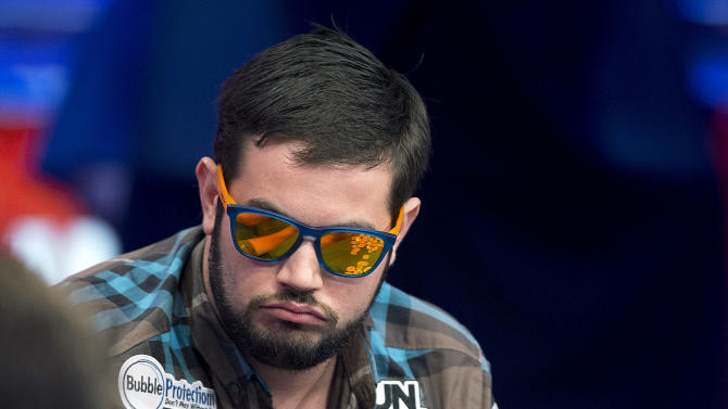 Robert Salaburu of San Antonio stacks his chips after winning a hand during the World Series of Poker Final Table event, Monday, Oct. 29, 2012, in Las Vegas. (AP Photo/Julie Jacobson)