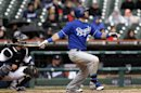 Kansas City Royals' Alex Gordon hits a grand slam against the Detroit Tigers pitcher Darin Downs in the 10th inning of a baseball game in Detroit, Thursday, April 25, 2013. (AP Photo/Paul Sancya)