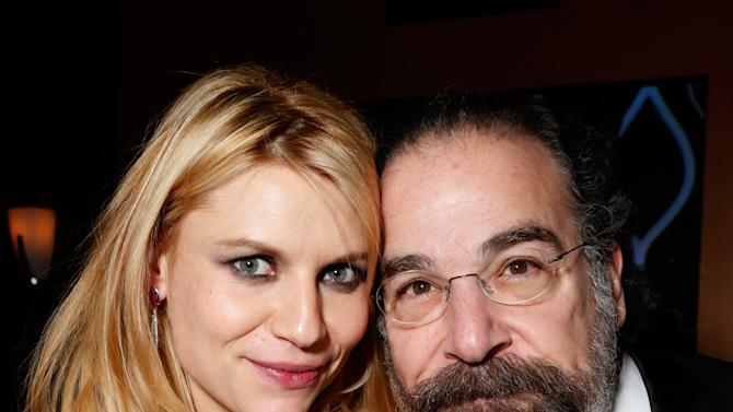 Claire Danes, left, and Mandy Patinkin attend the Fox Golden Globes Party on Sunday, January 13, 2013, in Beverly Hills, Calif. (Photo by Todd Williamson/Invision for Fox Searchlight/AP Images)