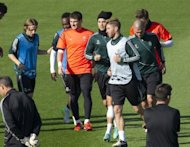 Real Madrid train at the Valdebebas training centre in Madrid on the eve of the UEFA Champions League football match against Borussia Dortmund. Coach Jose Mourinho is keen to end the side&#39;s decade-long Champions League drought